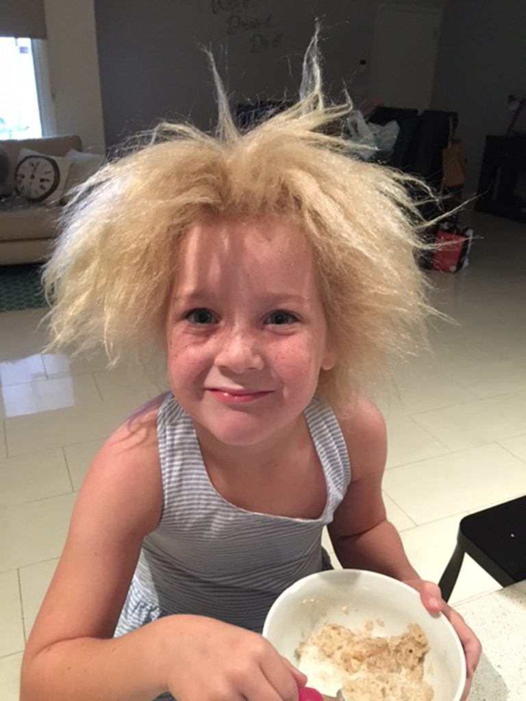 Adorable young girl has uncombable wild hair like Einstein ...