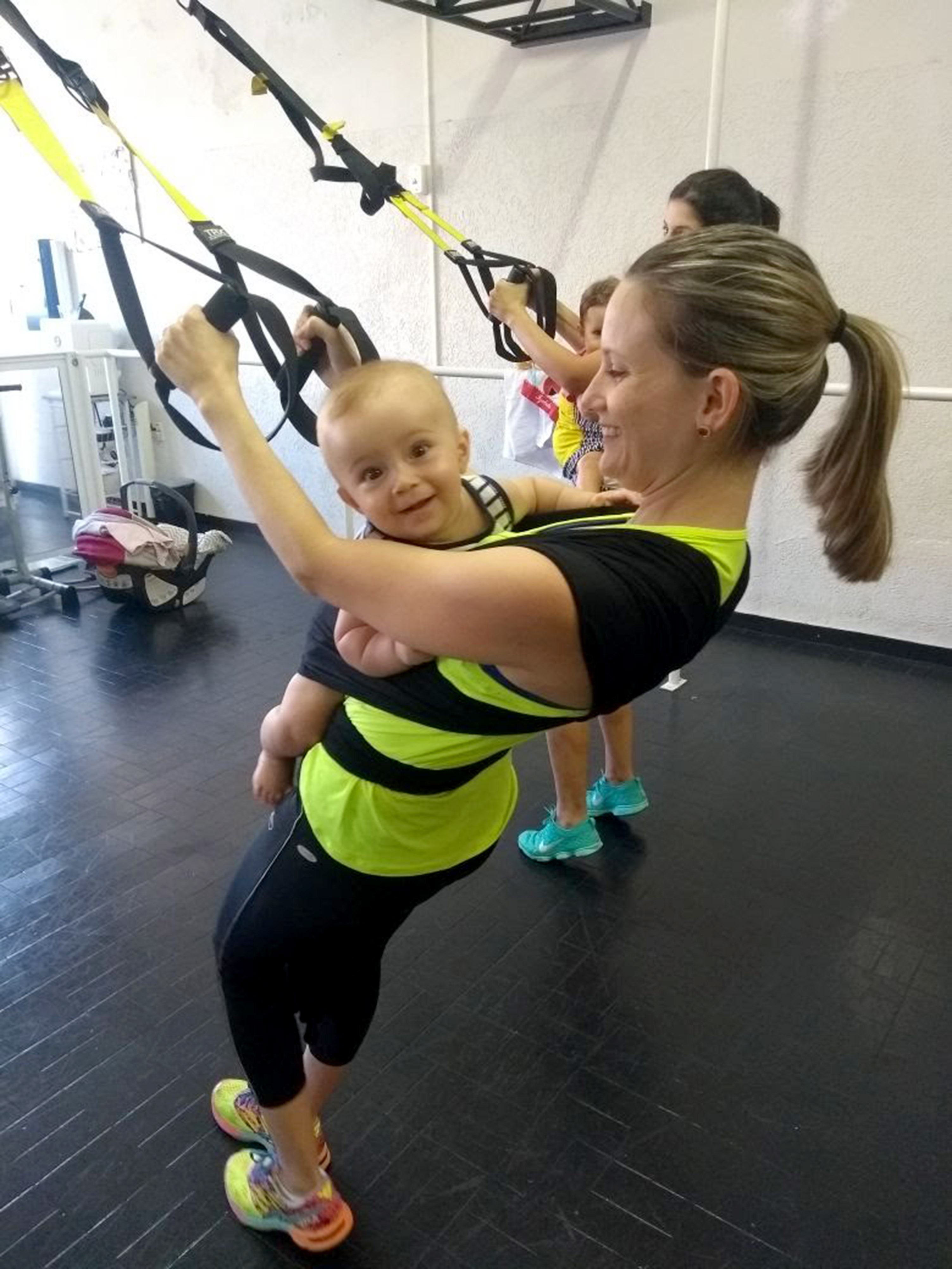 Gym babies add weight to mums' exercises - Caters News Agency