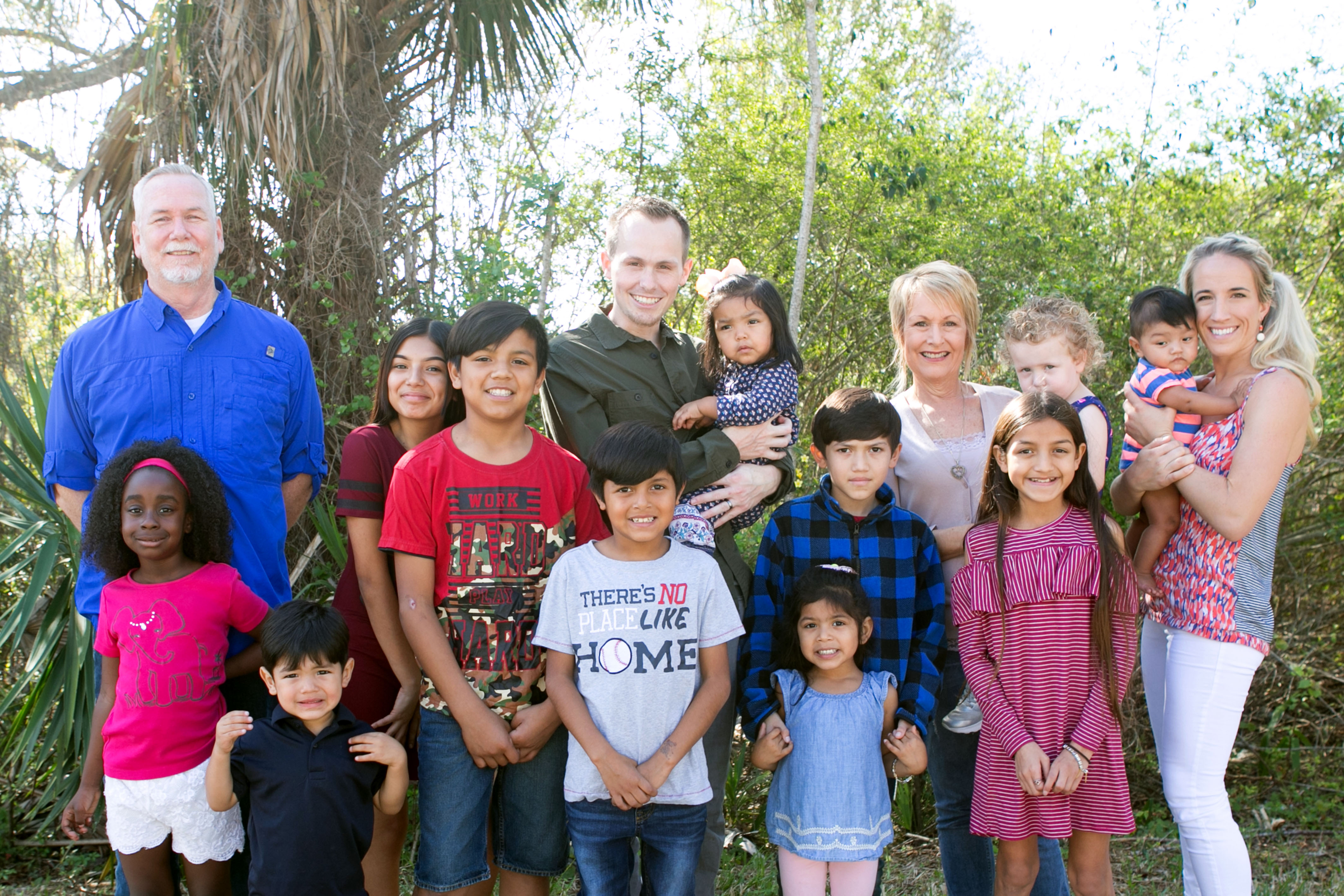 Family adopt nine children in one go so that all the ...