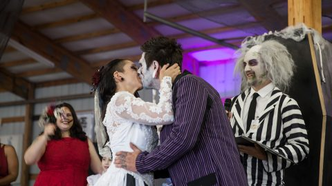 'Newlydead' couple organise zombie wedding with severed heads cake and ghoulish costumes Image