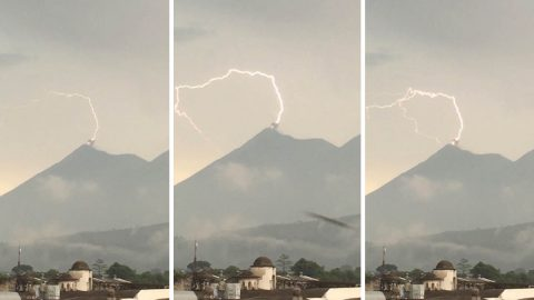 Illuminating footage captures lightning bolt strike erupting volcano Image