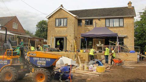Band of charitable builders secretly transform home of terminally ill man so he can play with children once again Image