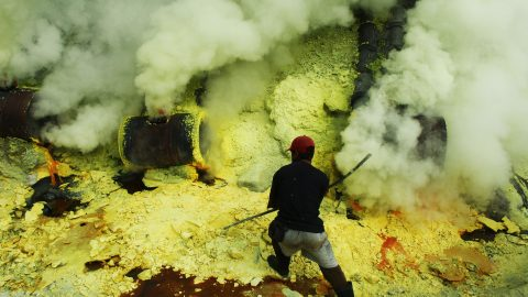 Heart-wrenching photos show miners working in perilous conditions to extract sulphur from stunning blue volcanic crater Image