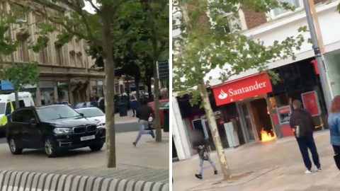 Shocking new footage of man 'who set fire to city centre bank while waving meat cleaver' – as eyewitnesses claim he shouted 'I want my money' Image