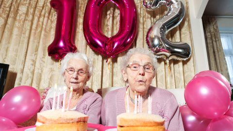 Double trouble! 102-year-old sisters celebrate becoming Britain's oldest twins Image