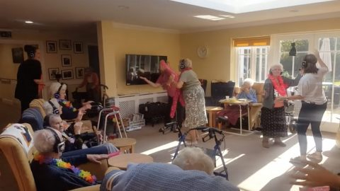 A day to remember: UK care home hosts first-ever silent disco for dementia patients in bid to stem the effects of the deadly condition Image