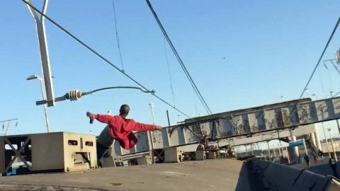 Is that James Bond? Bond style running man caught on top of train Image
