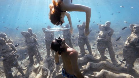 Lip-sink! Couple share beautiful moment in a bubble deep below sea level Image
