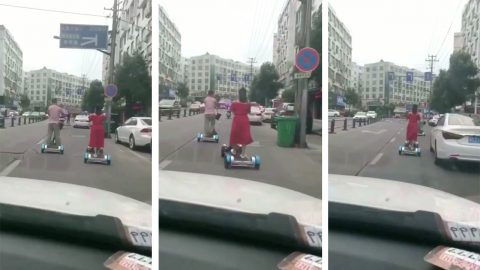 Road runners: Couple travel down middle of road while walking on bizarre treadmill scooter Image
