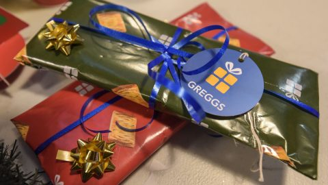 Deck the rolls: Greggs elves offer free festive steak bake wrapping to frazzled shoppers – and you can even buy sausage roll socks Image