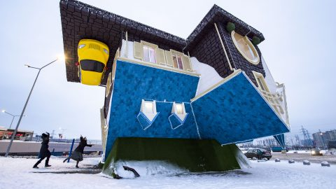 In the upside down! Stunning girls visit bizarre upside down house Image