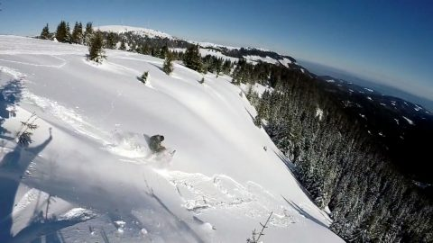 Breathtaking moment avalanche drags snowboarder 100 metres down hill Image