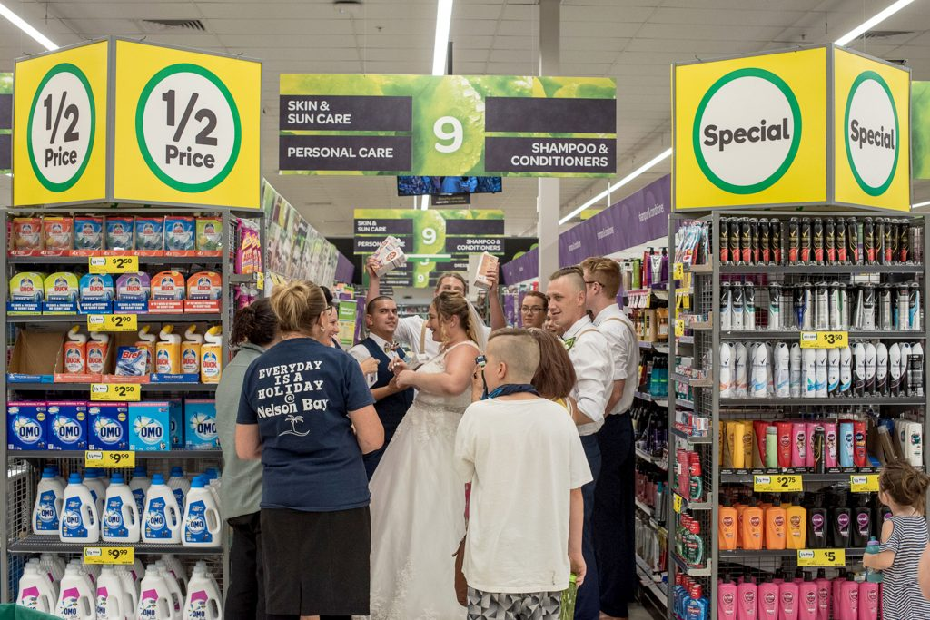 Pre-nup in aisle five! Bride poses for unforgettable wedding