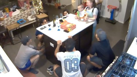 Hilarious moment baby trolls family with impromptu group squat session Image