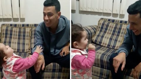 Heartwarming moment child uses sign language to communicate with deaf dad Image