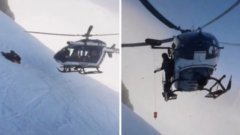 Skilful helicopter pilots almost touches mountainside with rotor blades in breathtaking rescue Image