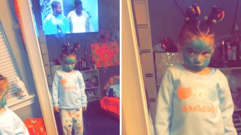 Hilarious little girl paints face green to look like ninja turtle Image