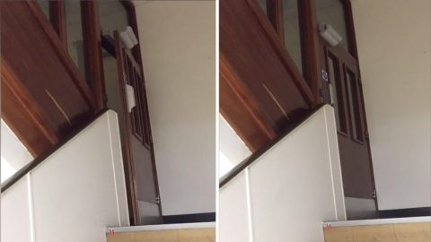 Creepy Paranormal Activity In Old Mental Wing Of A Hospital As An Eerie Door Creaks Open And Shut In Without Visible Assistance Image