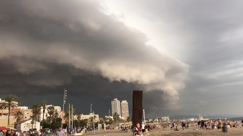 Dramatic Moment Frightening Shelf Cloud Inches Over Crowded Beach Image