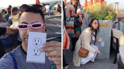 Prankster confuses bar customers who want to charge their phone with fake electrical outlet sticker Image