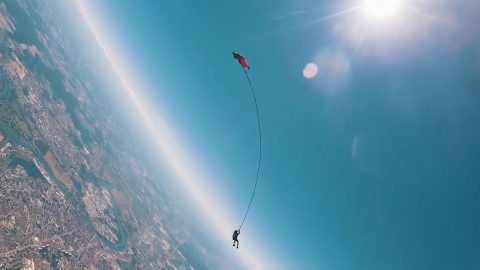 DAREDEVILS PERFORM WORLD'S FIRST BUNGEE JUMP WHILE TIED TO A WINGSUIT PILOT Image