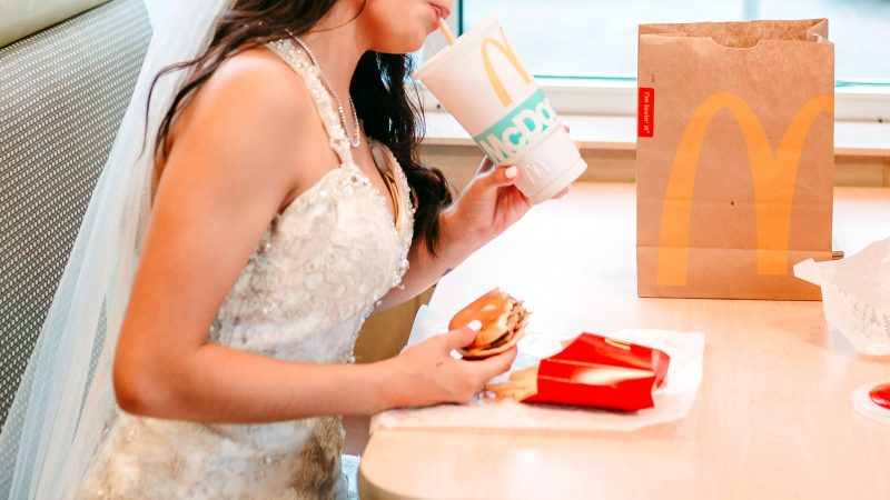 HERE COMES THE FRIES - STUNNING BRIDE FULFILS HER 'DREAM' OF HAVING FIRST MEAL WITH HUBBY AT MCDONALD'S ON HER WEDDING DAY Image