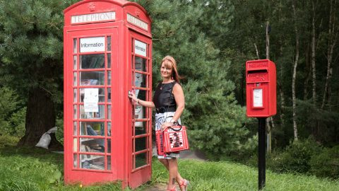 MUM WITH PHONE BOX OBSESSION SPENDS £3,000 ON MEMORABILIA – AND EVEN POSES IN ICONIC RED BOX IN UNDERWEAR Image