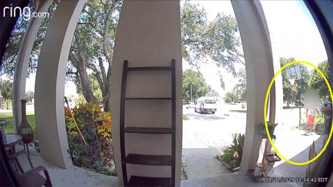 DOORBELL CCTV FOOTAGE SHOWS AMAZON DRIVER TAKING CHILD'S BIKE FROM DRIVEWAY Image