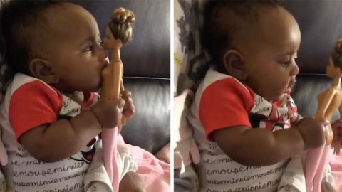 HUNGRY BABY TRIES TO BREASTFEED FROM BARBIE DOLL AS MUM LOOKS AFTER BROTHERS Image