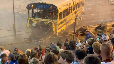 SCHOOL BUS RACE TAKES DANGEROUS TURN AS CRASH CAUSES VEHICLE TO PLOUGH THROUGH FENCE BETWEEN TRACK AND SPECTATORS Image