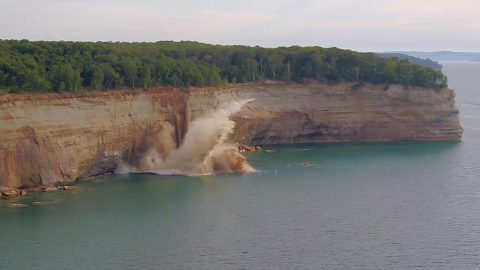TERRIFYING MOMENT MASSIVE CLIFF FALLS CLOSE TO KAYAKERS Image