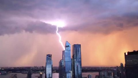 SPECTACULAR MOMENT LIGHTNING STORM AND SUNSET APPEAR IN SYNC OVER CITY Image