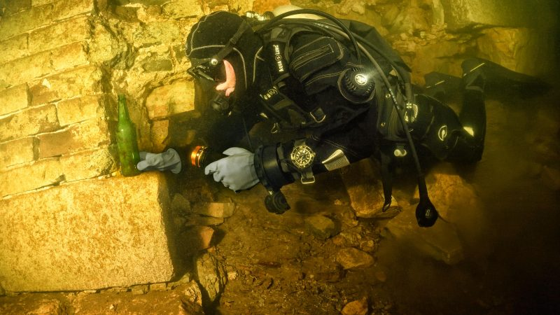 SCUBA DIVERS SWIM THE GREAT WALL OF CHINA Image