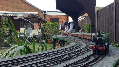 THREE GENERATIONS OF SAME FAMILY BUILD MINIATURE RAILWAY ACROSS BACK GARDEN WHICH IS NOW TOURIST ATTRACTION Image