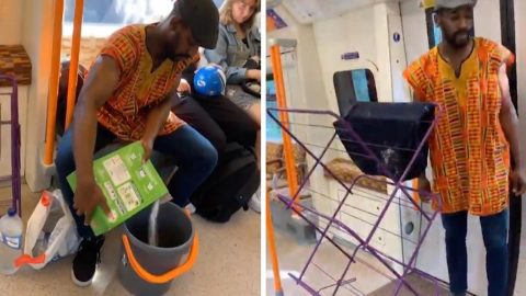 PRANKSTER CONFUSES COMMUTERS BY WASHING CLOTHES ON TRAIN JOURNEY Image