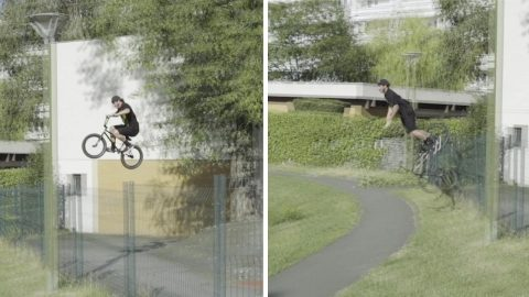 BMX RIDER SKILFULLY FLIPS OFF THE FRONT OF HIS BIKE AFTER LANDING IN FENCE Image