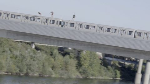 SHOCKING MOMENT DAREDEVILS JUMP FROM MOVING TRAIN INTO RIVER Image