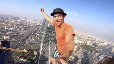DAREDEVIL SMASHES WORLD RECORD FOR HIGHEST URBAN HIGHLINE EVEN PERFORMING YOGA ABOVE CITY Image