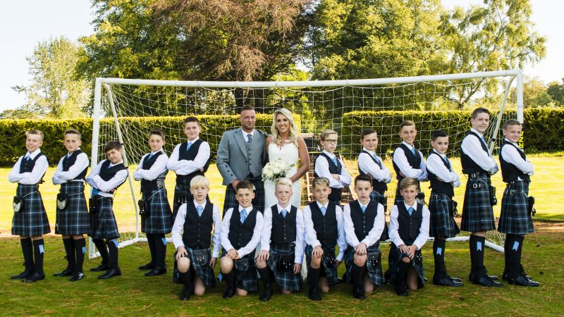 HITCHED ON THE PITCH! BRIDE AND GROOM CHILDREN'S FOOTBALL COACHING DUO GET MARRIED WITH ENTIRE 18-STRONG SQUAD AS USHERS Image