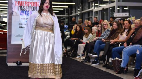 DOWN'S SYNDROME TEEN TURNED MODEL STRUTS FIRST MAJOR CATWALK SHOW – AFTER FIGHTING BACK FROM THREE-YEAR CANCER BATTLE WHICH LEFT HER UNABLE TO WALK AND SPEAK Image