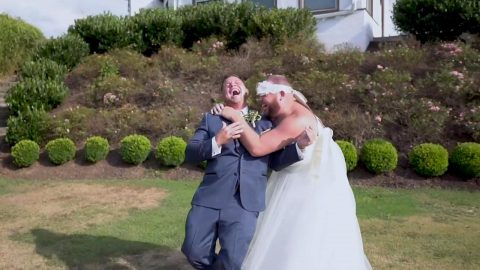 YOU MAY NOW KISS THE... BEST MAN: GROOM EXPECTING TO SEE HIS BEAUTIFUL BRIDE FOR THE FIRST TIME IS SHOCKED TO SEE HIS BEST FRIEND IN A WEDDING DRESS IN HILARIOUS PRANK VIDEO Image