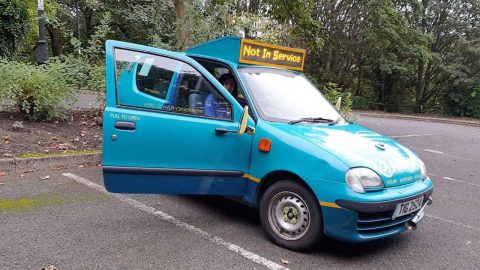 BUS OBSESSIVE OWNS FOUR SEATER CAR WHICH HAS BEEN TRANSFORMED INTO BRITAINS SMALLEST BUS Image