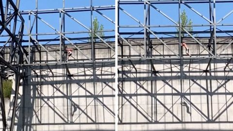 BRAVE DAREDEVIL SWALLOWS FEAR BY HOPPING ACROSS THIN BEAMS Image