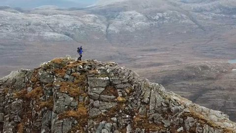 STOMACH-CHURNING DRONE FOOTAGE SHOWS DAREDEVIL HIKER SCALING TERRIFYING PEAKS AND RIDGES OF HIGHEST HILLS IN UK – ALL WITHOUT USING FOOTPATHS Image