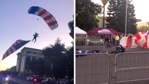 UNLUCKY PARACHUTIST FLYING UNITED STATES FLAG CRASH LANDS ON TO ROAD Image