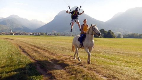DAREDEVIL PARAGLIDER PROVES NEIGHSAYERS WRONG BY LANDING ON TO MOVING HORSE Image