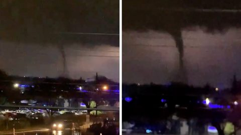 MOMENT LIGHTNING BOLT REVEALS TERRIFYING TORNADO RUSHING THROUGH CITY Image