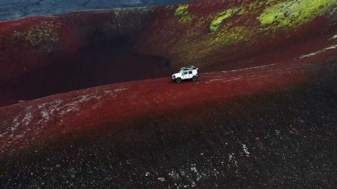 ADVENTURERS FIND GLOWING RED AND GREEN VOLCANIC CRATER NAMED AFTER APPLE Image