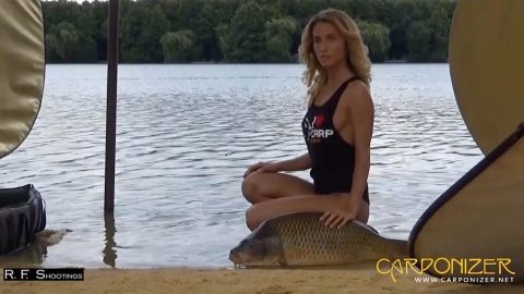 THIS SCANTILY CLAD CALENDAR COMES WITH ONE DIFFERENCE – THE BEVVY OF BEAUTIES POSE WITH GIANT CARP Image