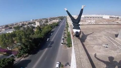 DAREDEVIL PERFORMS WORKOUTS OUT ON EDGE OF BUILDINGS AND CRANES IN HAIR-RAISING FITNESS VIDEOS Image